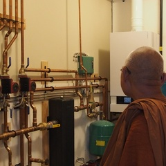 Luang Por Liem takes a look inside the machine room in the bhikkhu vihara