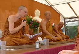 Ajahn Thaniyo reads a translation of Luang Por Liem's talk on the day of the ceremony for the upcoming meditation hall