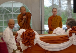 Tan Suvijjano reads the Thai script on the stone to be embedded in the upcoming meditation hall