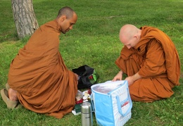 Vens. Atulo and Sallekho prepare offerings during a trip to the arboretum in Ottawa