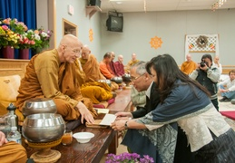 Luang Por Viradhammo accepts an offering