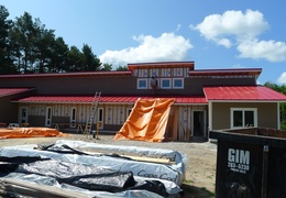A view of the front.  The roof is on and the siding is coming up