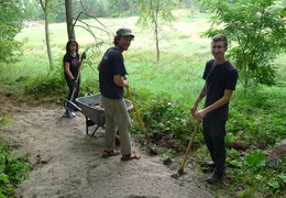 Peter and his crew rake gravel out on the path
