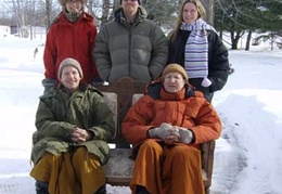 Ajahn Kusalo, Ajahn Viradhammo and guests take a photo in the snow