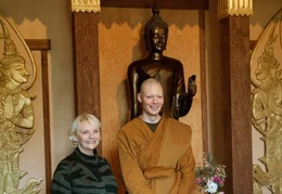 Sumangalo bhikkhu takes a photo with his mother