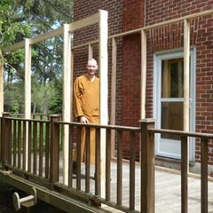 The porch is getting framed in.  A roof will be put on in preparation for Luang Por Sumedho's upcoming visit.