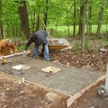 A new concrete slab was poured just outside the barn in order to house the port-o-potties