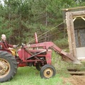 Moving outhouses is not a problem for the ol' tractor