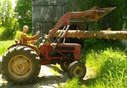 Ajahn Kusalo moves a log with the tractor