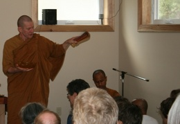 Ajahn Kusalo chants blessings for the assembled laity