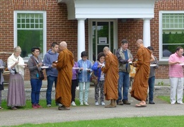 Another photo of the senior monks collecting alms