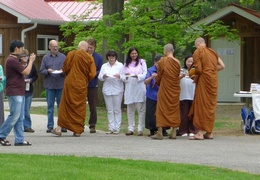The senior monks collect alms