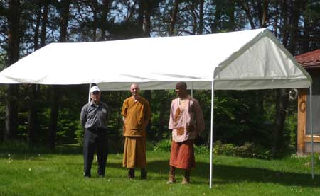 L to R: Crawford, Ven. Sumangalo and Samanera Atulo under the food receiving tent